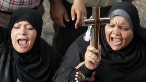 Muslim women with cross